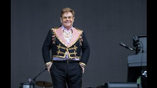Sir Elton John looking to settle ex-wife's lawsuit out of court