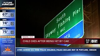 Child dies after being hit by a car