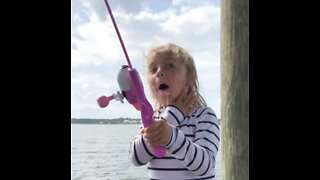 Child is ecstatic as she catches first fish!