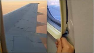 This airplane window doesn't seem very secure...