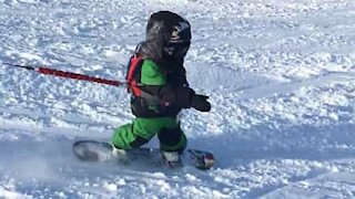 Three-year-old snowboards like a pro