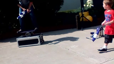 Cheeky Kid Upstages Juggler During Street Performance
