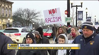 Hundreds of people rally against racism in Saline