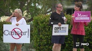 Dozens protest Punta Gorda sign ordinance, displaying profanity along Route 41