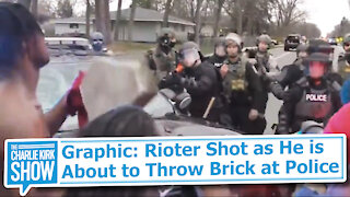 Graphic: Rioter Shot as He is About to Throw Brick at Police