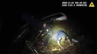Caught on camera: Alliance officers rescue woman from a submerged car after she drove into river