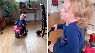 Asleep At The Wheel: Adorable Toddler Can't Keep Eyes Open Behind Wheel Of Police Trike