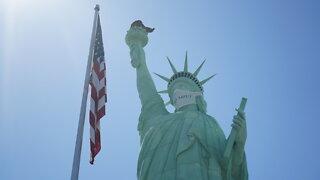 Statue of Liberty wearing a mask