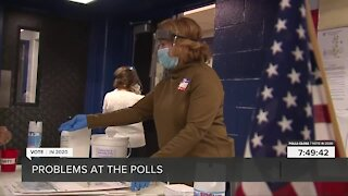 Volunteers work to solve issues at polling stations on Election Day