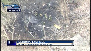 Body found inside burned car on Detroit's east side