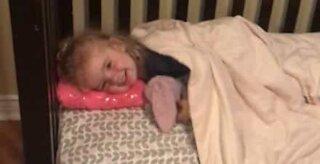 Dog kisses little girl goodnight