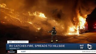 Fire engulfs RV off I-805 in National City, spreads to brush
