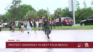 Protest marches through downtown West Palm Beach