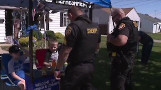 2 young boys raising money for families of fallen Cleveland police officers