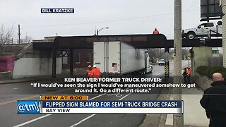 Truck driver loses job after getting stuck under Bay View bridge, blames clearance sign