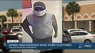 Masked man robs woman at Publix