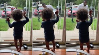 Heartwarming scene as toddler welcomes daddy home from work
