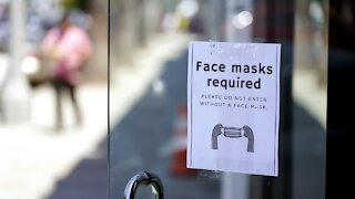 CDC recommends vaccinated people wear masks indoors where virus is surging