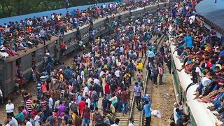 Thousands of people filmed train surfing their way to Eid festivities in overpopulated capital