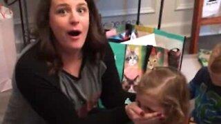 Little girl swears when she opens present