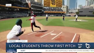 Local students throw first pitch