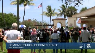 Group of protesters gather in Lake Worth Beach, 2 people attempt to burn American flag
