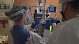 Navy medical personnel assist with COVID-19 patients at St. Luke's Hospital