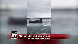 Michigan man rescued after his truck falls through the ice