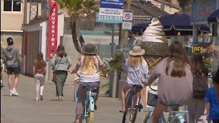 San Diego businesses benefiting off spring break traffic, officials continue to warn about pandemic safety