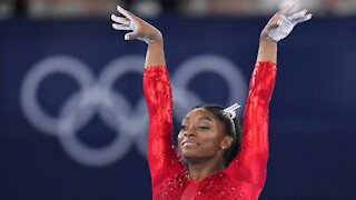 Putting 'Mental Health First,' Biles Withdraws from Team Competition