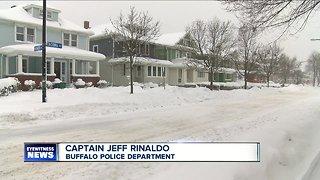 Woman finds burglar in home after shoveling