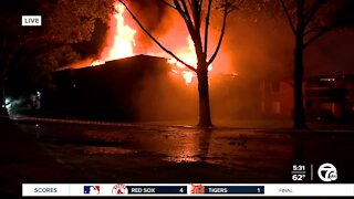 Crews continue to battle massive apartment fire in Westland