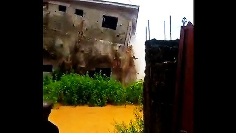 Video captures the incredible moment house collapses in deadly flood