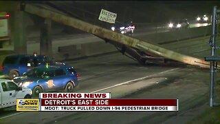 MDOT: Truck pulled down I-94 pedestrian bridge