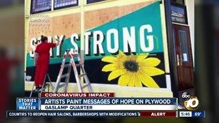 Artists paint murals downtown
