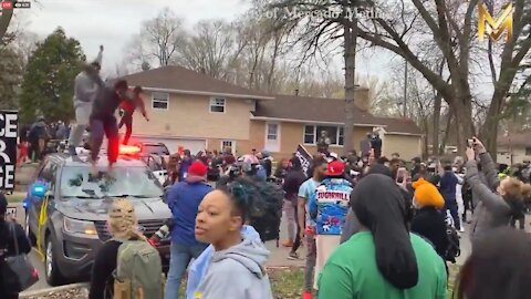 WATCH: BLM Protest Gets Out of Control as Protestors Jump on, Try to Destroy Police Cars