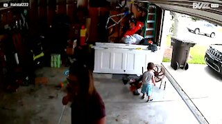 Toddler hitches lift on garage door