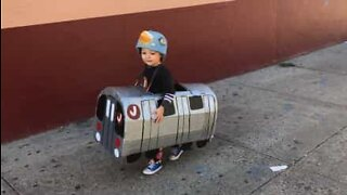 Little boy dresses up as a subway train for Halloween