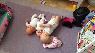 Adorable Baby Plays With Baby Dolls