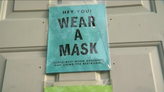 Local businesses hesitant to ditch mask requirements, despite CDC guidance