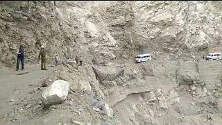 Watch this van get stuck hanging over a cliff