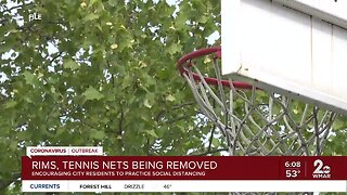 Rims, tennis nets being removed