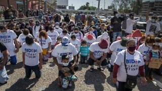 Illegal aliens arrive at the border wearing 'Biden Let Us In' shirts