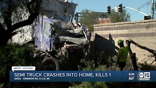 Latest after a semi-truck crashed into a home killing one person