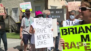 Protesters gather outside Brian Mast's office, call for his resignation