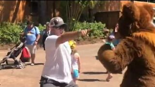 Dad dances hilariously with a bear