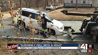 Car falls into a sinkhole