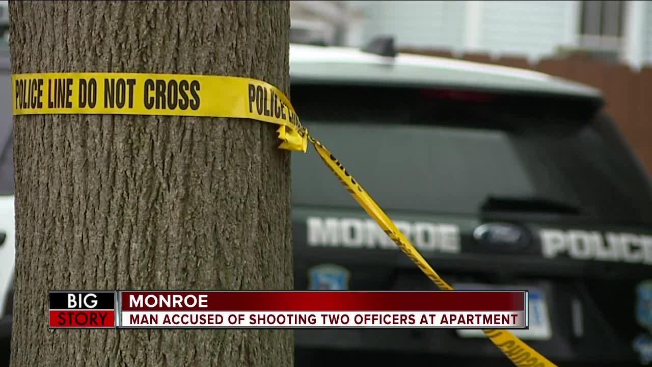 2 police officers injured in shooting at apartment complex in Monroe