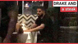 Drake spotted with a mystery woman
