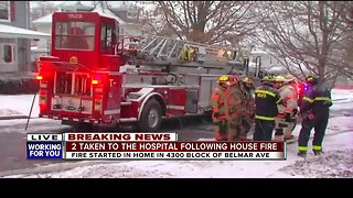 Two people taken to hospital after house fire in Overlea
